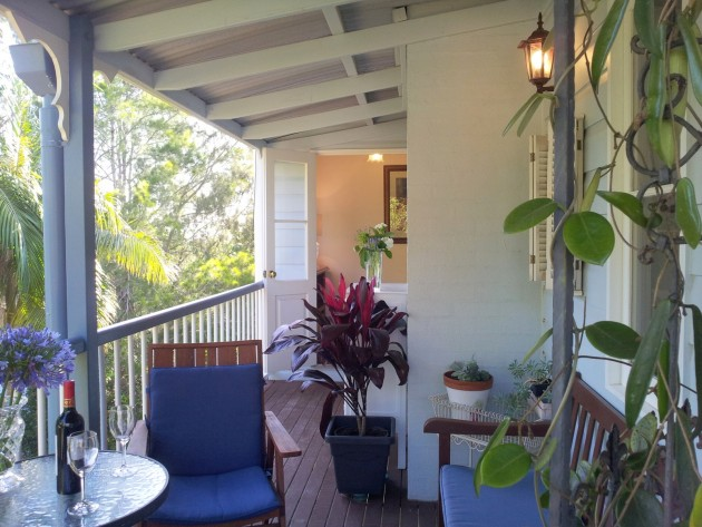 Relax with a wine on the verandah of your accommodation in Tamborine Mountain